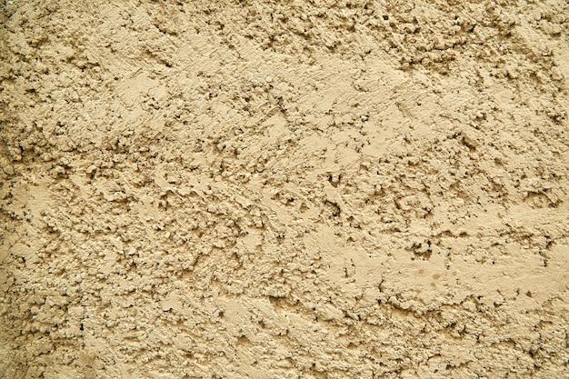 Textura de um fundo de parede de areia rachada