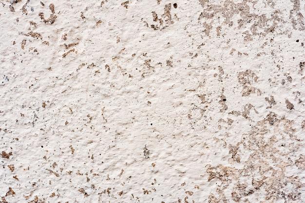 Textura de um muro de concreto com rachaduras e arranhões