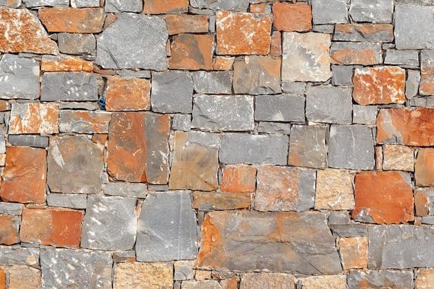 Textura de um muro de pedra. fundo velho da textura da parede de pedra do castelo. s