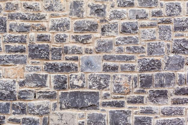 Textura de um muro de pedra. fundo velho da textura da parede de pedra do castelo.