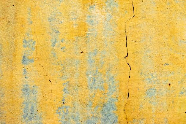 Textura de uma parede de concreto com rachaduras e arranhões que podem ser usados como fundo