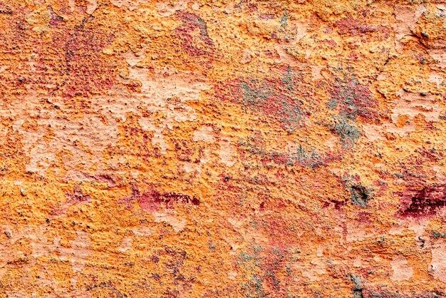 Textura de uma parede de concreto com rachaduras e arranhões que podem ser usados como pano de fundo