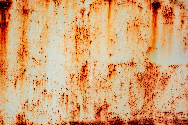 Textura de uma parede de metal com ferrugem