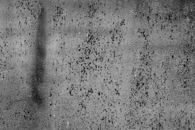 Textura de uma parede de metal com rachaduras e arranhões que podem ser usados como fundo
