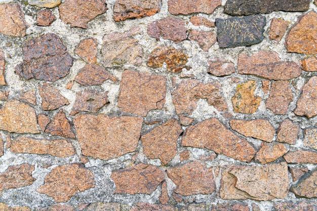 Textura de uma parede de pedra. antigo fundo de textura de parede de pedra do castelo.