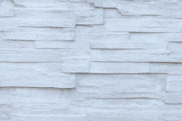 Textura de uma parede de pedra cinza.