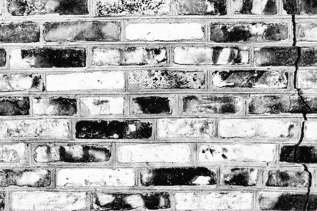 Textura de uma parede de tijolos com rachaduras e arranhões que podem ser usados como fundo