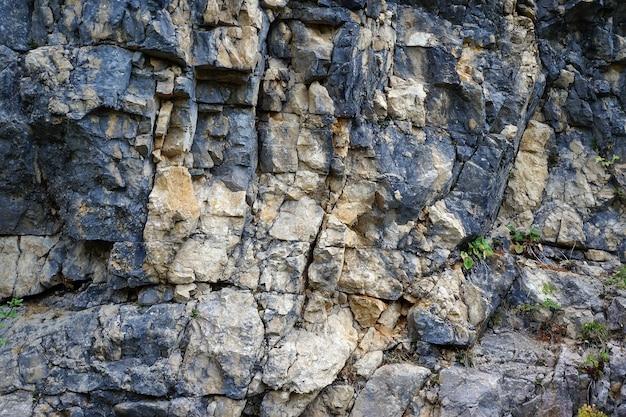 Textura de uma pedra, a rocha regada. fundo, textura grunge.