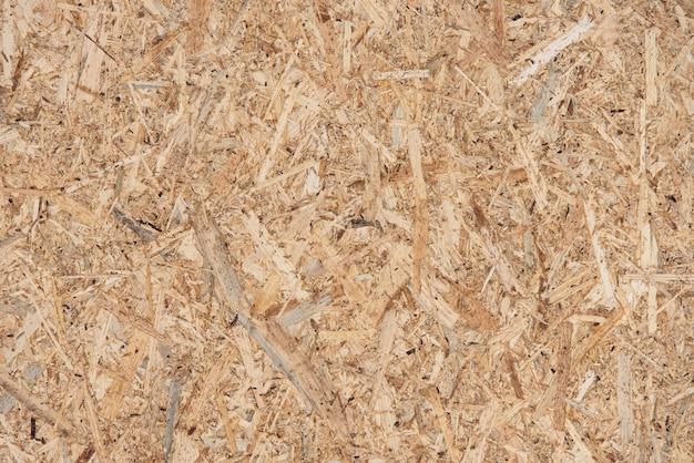 Textura de uma placa de madeira de aparas compactadas