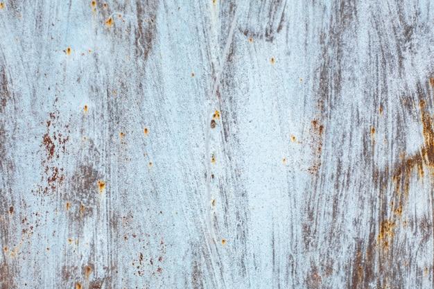 Textura de uma velha folha de metal enferrujada pintada
