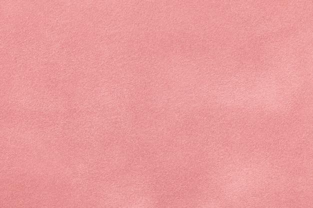 Textura de veludo de tecido rosa camurça matizada,