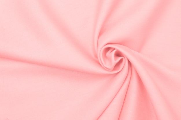 Textura delicada maravilhosamente amassada de tecido rosa