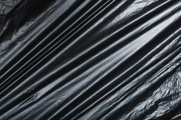 Textura descartável de saco de lixo preto