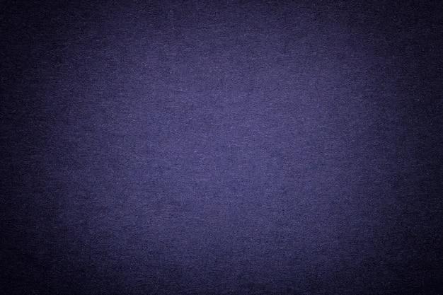Textura do antigo fundo de papel azul marinho, closeup