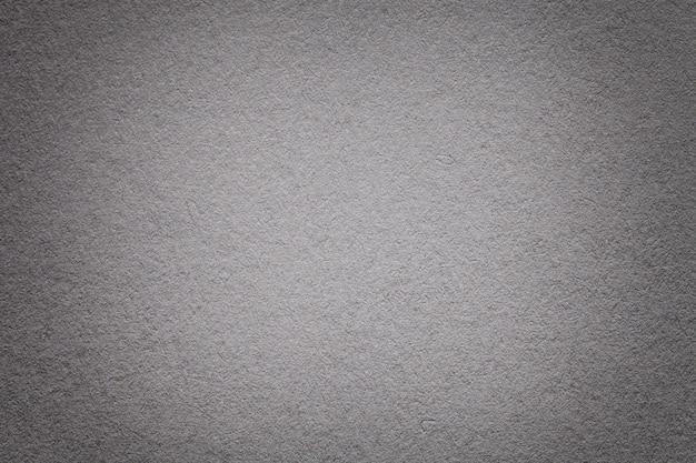 Textura do antigo fundo de papel cinza escuro