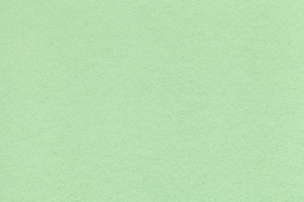 Textura do antigo papel de luz verde closeup