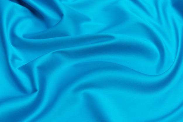 Textura do close up de tecido azul natural ou pano na cor da água da maré.