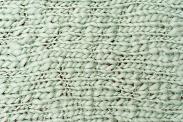 Textura do cobertor grande da malha de lã verde. grande tricô. merino xadrez. vista do topo