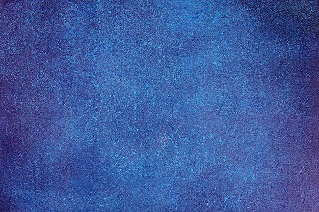 Textura do espaço na madeira compensada pintada. a textura do céu estrelado da noite.