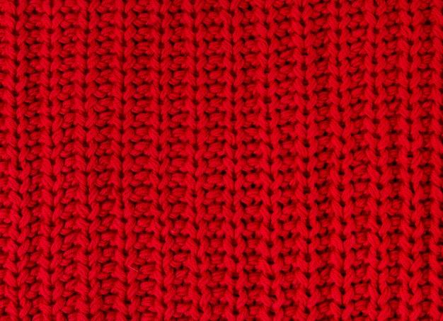 Textura do fim feito malha vermelho da tela acima. malhas de lã