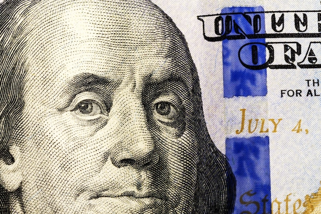Textura do fragmento da nota de dólar. fragmento de cem dólares americanos