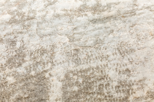 Textura do fundo cinzento da parede áspera concreta.