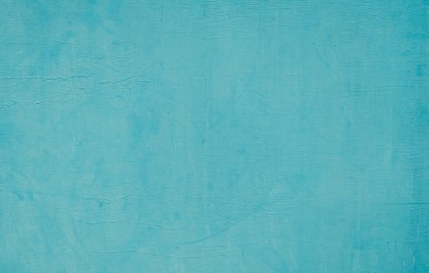 Textura do fundo da parede de tinta azul turquesa