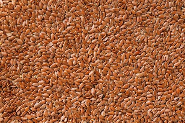 Textura do fundo das sementes do linho marrom escuro.