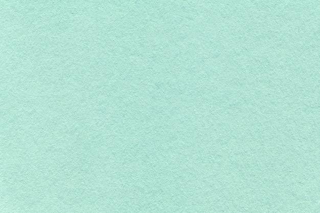 Textura do fundo de papel ciano claro velho,