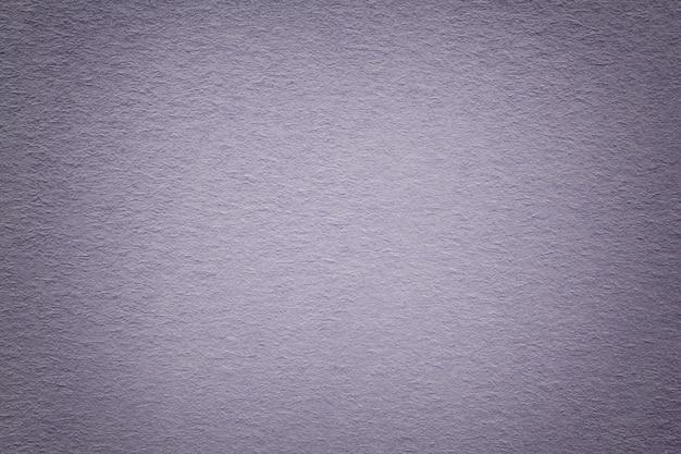 Textura do fundo de papel cinzento velho, close up.