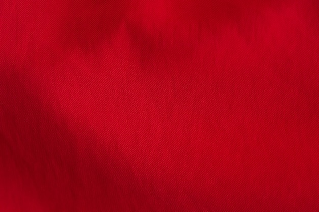 Textura do fundo do cutton vermelho ondulado.
