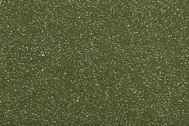 Textura do fundo velho do papel verde, close up. estrutura de papelão de azeitona densa.