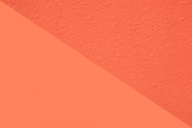 Textura do muro de cimento alaranjado. fundo com espaço para texto.