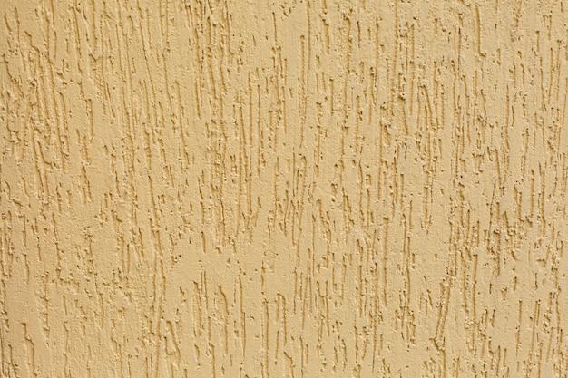 Textura do muro de cimento amarelo. parede de cimento amarelo lindo