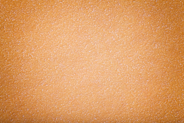 Textura do papel alaranjado velho, close up. estrutura do cartão de coral denso.