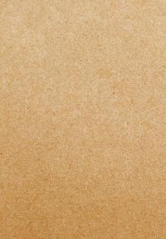 Textura do papel do tom de brown para o fundo.