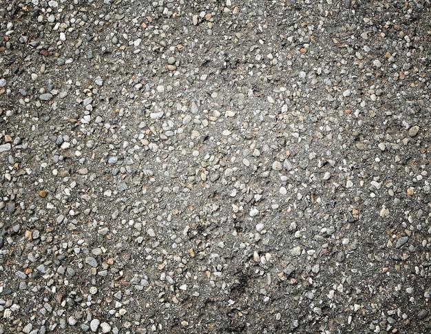 Textura do pavimento asfáltico com cascalho para o fundo