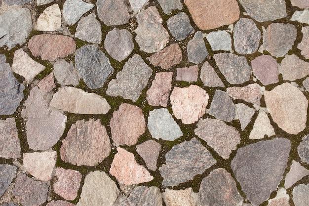 Textura do pavimento de pedra, ladrilhos de paralelepípedos, fundo de tijolos
