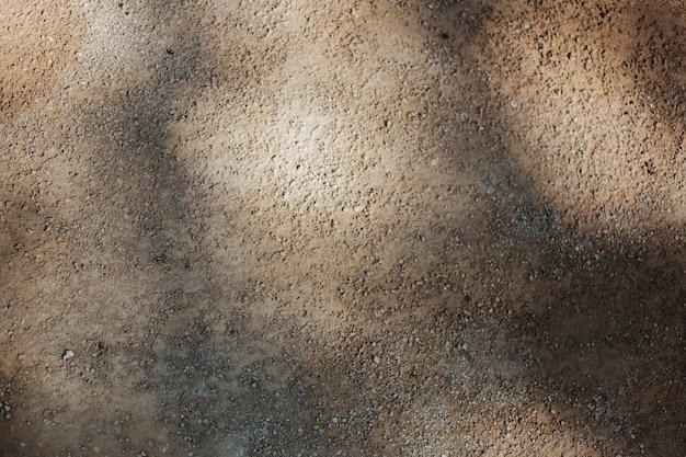 Textura do solo com raios solares