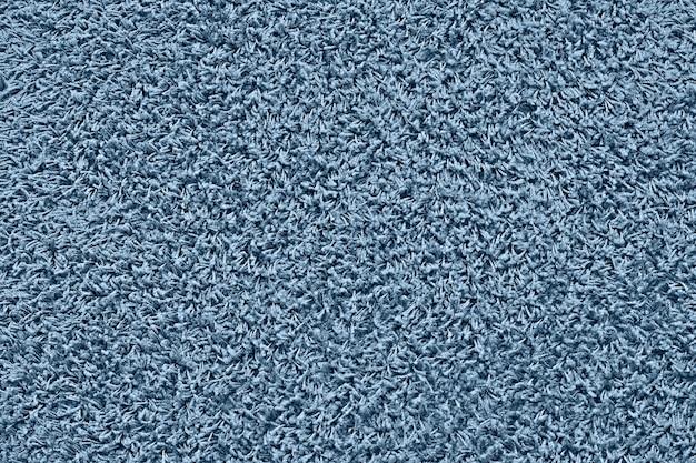 Textura do tapete, fundo azul clássico da cor. chão. pano de fundo.