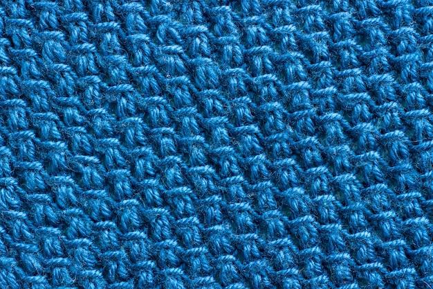 Textura do tecido amarrado com fio azul.
