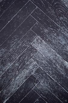 Textura do velho parquet escuro como superfície