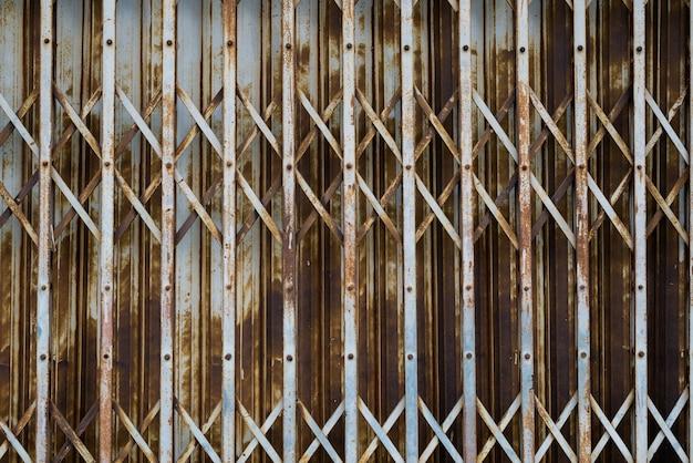 Textura dobrável de aço enferrujada da porta, porta velha do obturador do estilo da forma