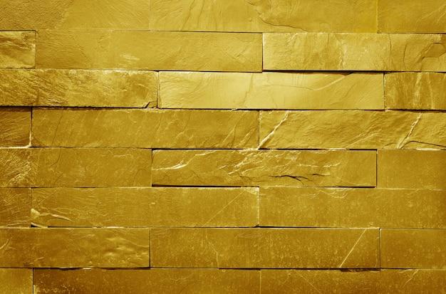 Textura dourada da parede de tijolo da pedra da ardósia no teste padrão natural com alta resolução para o trabalho de arte do fundo e do projeto.
