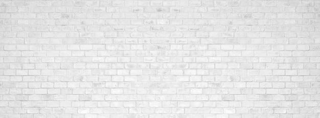 Textura e fundo brancos da parede de tijolo.