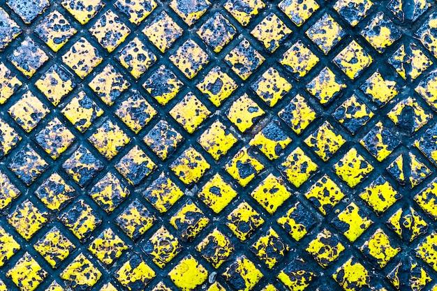 Textura e fundo da cor amarela da placa de metal
