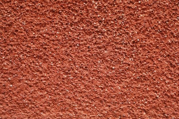 Textura e fundo da parede de concreto vermelho