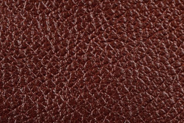 Textura e fundo de couro marrom vermelho