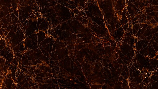 Textura e fundo de mármore pretos e dourados.