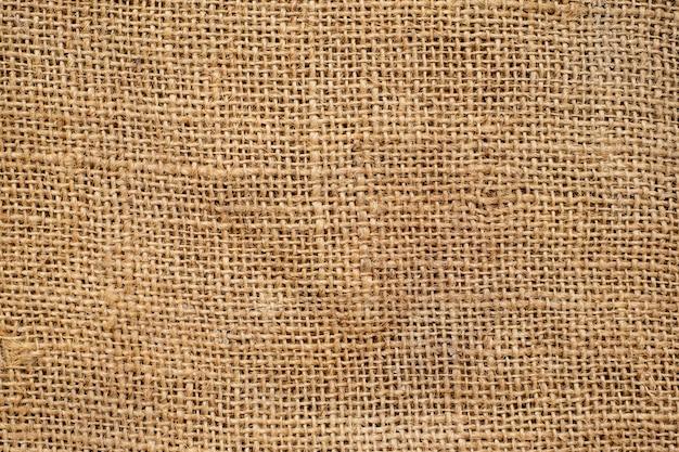 Textura e fundo de pano de saco marrom.